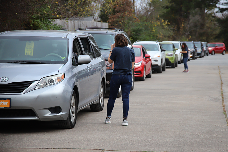 Cars lined up to  get free turkeys at Asbell Elementary on Friday, November 20th.