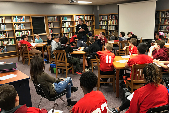 "Dr. Hershey Garner discusses genomes, cancers, and healthcare with Ramay Junior High students who are reading ""Drums, Girls, and Dangerous Pie."" #onefps"