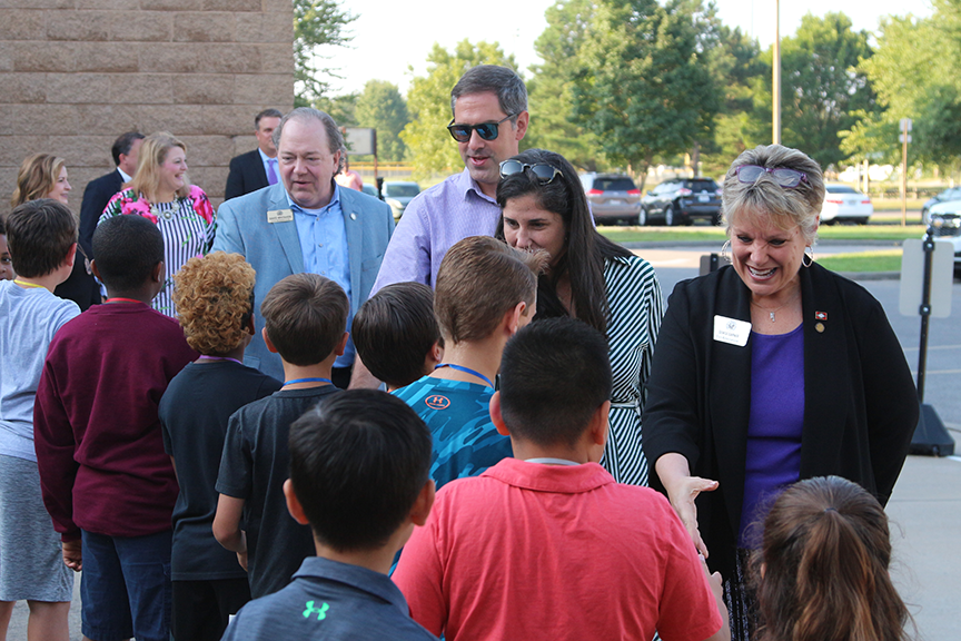 Picture of  Rep. Nicole Clowney, Rep. Denise Garner, Sen. Greg Leding, and Rep. David Whitaker with two students greeting students.