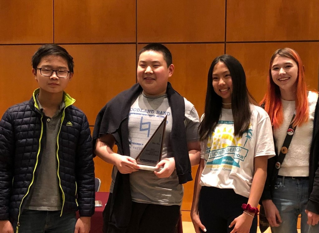 The Woodland Math Club had six students who competed in the State MathCounts competition in Little Rock on Saturday. Alejandra and Laura Avila, Albert Lui, Keming Meng, Maddie Mullins, and Annie Xu all competed as individuals. Our team: Albert Lui, Keming Meng, Maddie Mullins, and Annie Xu received the 1st Place Team award, and Keming Meng took 6th Place in the Individual Competition. CONGRATULATIONS!
