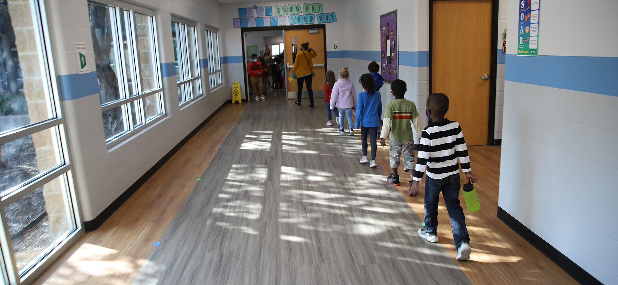 FPS students walk down the hall.